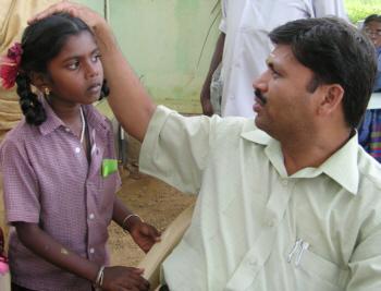Dr. Ganapathy examining patient